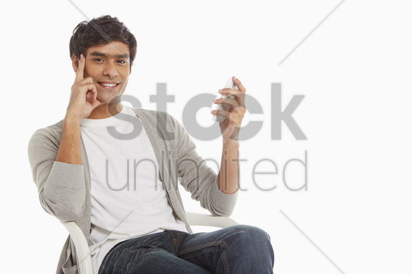 man sitting on a chair, text messaging stock photo