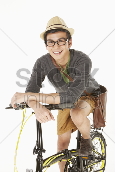 man sitting on the bicycle, smiling stock photo