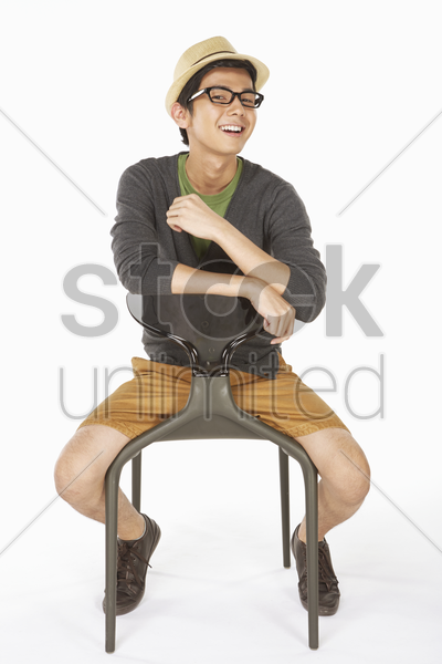 man sitting on the chair, smiling stock photo