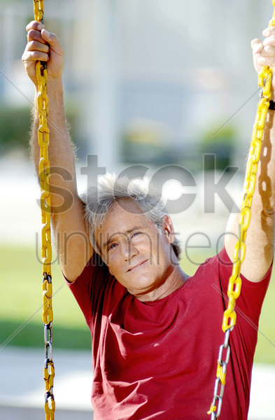 man sitting on the swing stock photo
