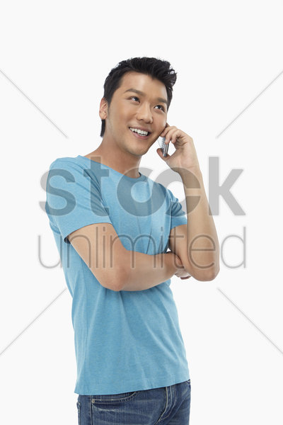 man smiling and talking on the phone stock photo