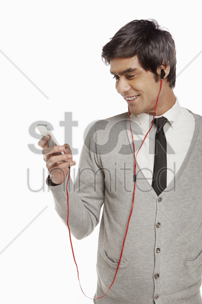man smiling and using mobile phone stock photo