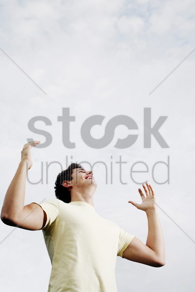 man smiling while looking up stock photo