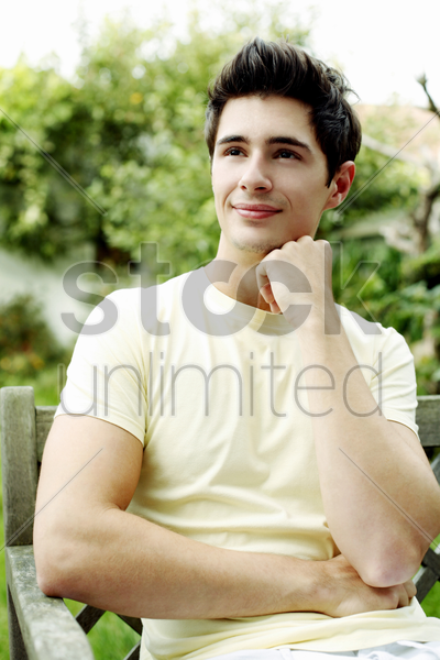 man smiling while thinking stock photo