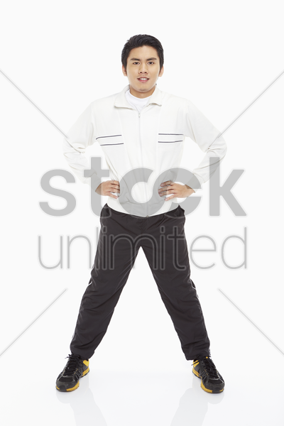 man standing and smiling at the camera stock photo