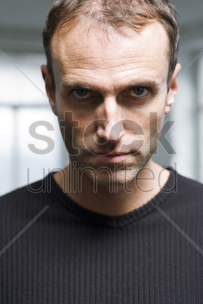 man staring at the camera stock photo