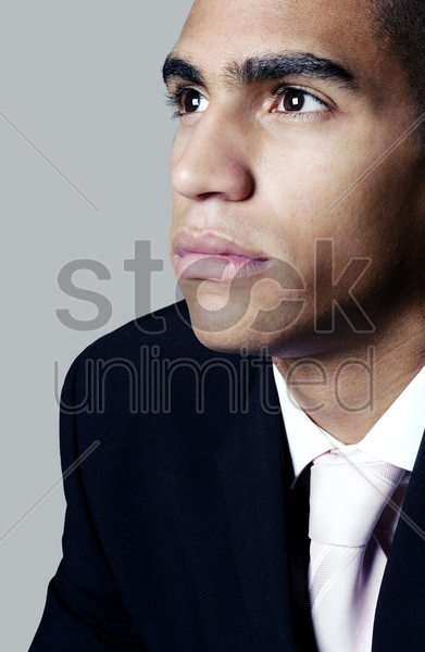 man staring blankly at a space stock photo