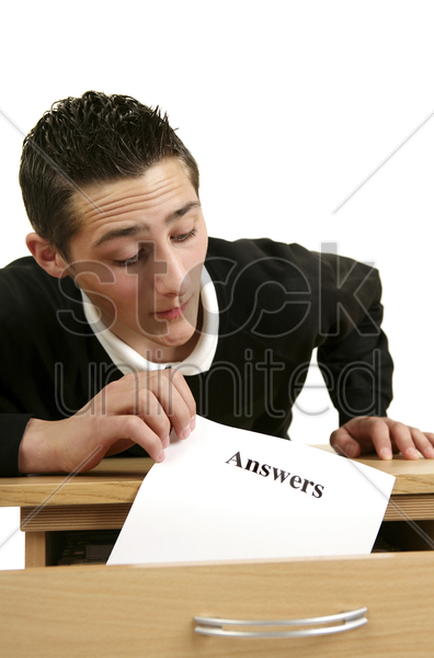 man stealing test answers stock photo