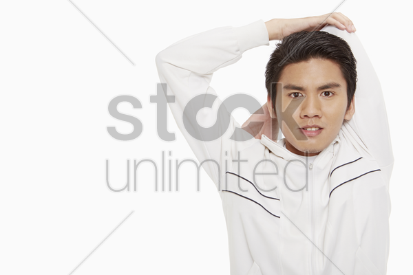 man stretching his arm stock photo