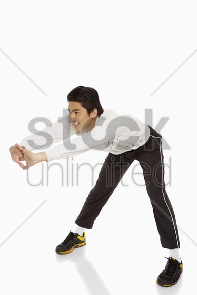 man stretching his back stock photo