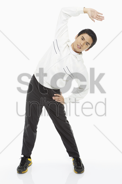 man stretching his body, going towards the left stock photo