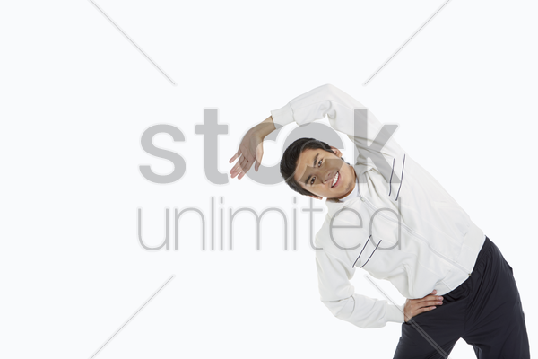 man stretching his body, going towards the right stock photo
