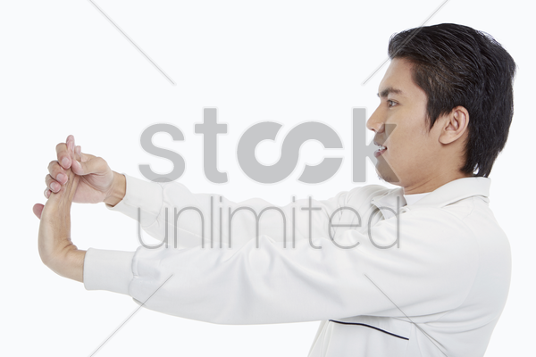 man stretching his left palm stock photo