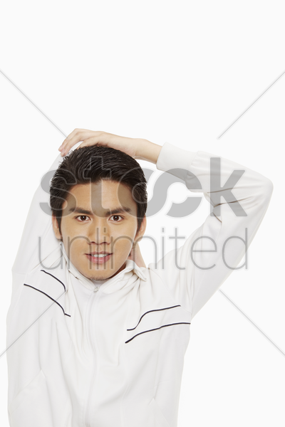 man stretching his right arm stock photo