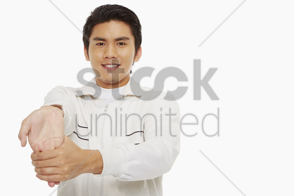 man stretching his right palm stock photo