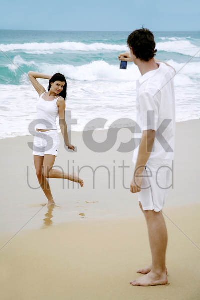 man taking picture for his girlfriend stock photo