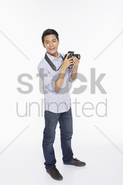 man taking pictures with a digital camera stock photo