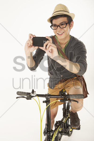 man taking pictures with mobile phone stock photo