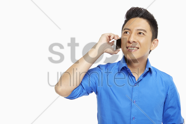 man talking on his mobile phone stock photo