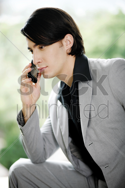 man talking on the mobile phone stock photo
