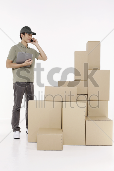 man talking on the phone while checking the packages stock photo