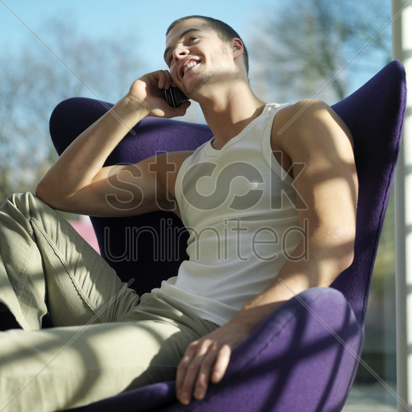 man talking on the phone stock photo