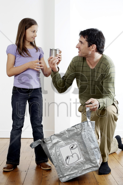 man teaching girl about recycling stock photo