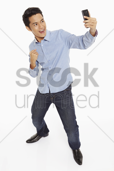 man text messaging using mobile phone stock photo