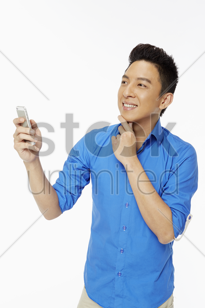 man text messaging with his mobile phone stock photo