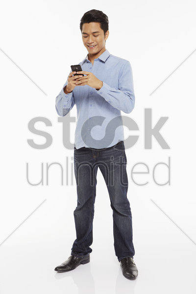 man text messaging with mobile phone stock photo