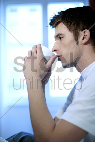 man thinking while drinking coffee stock photo