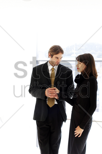 man touching a woman's hand stock photo