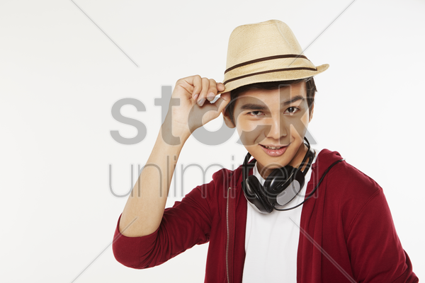 man touching the tip of his hat stock photo