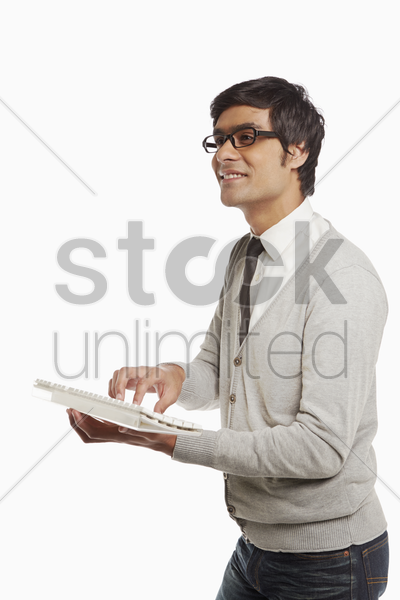man typing on a computer keyboard stock photo