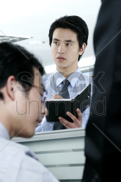 man updating his organizer stock photo