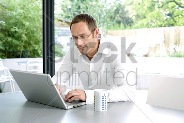 man using laptop stock photo