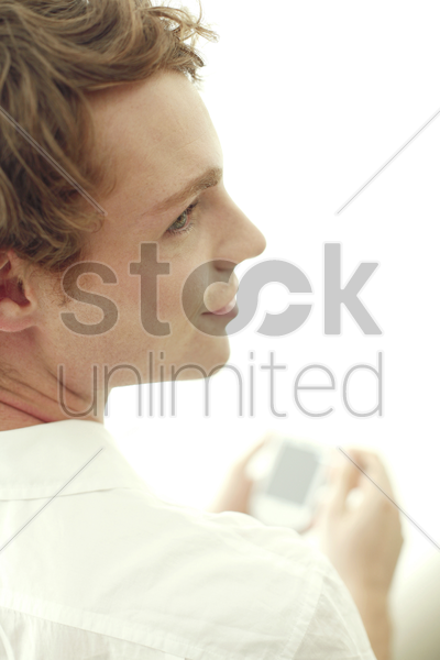 man using palmtop stock photo
