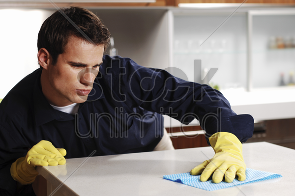 man wiping the table stock photo