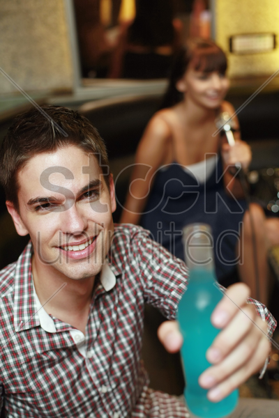 man with a bottle of drink stock photo