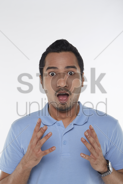 man with a shocked expression stock photo