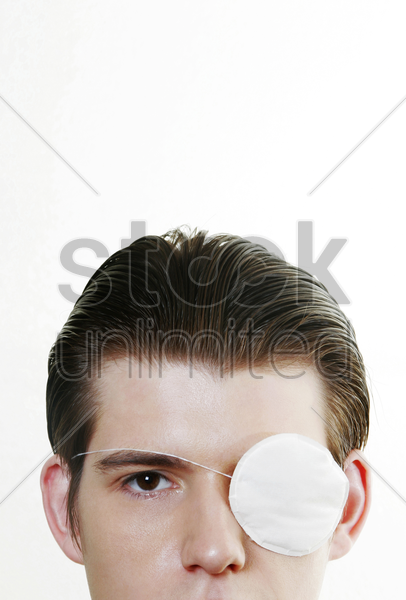 man with an eye-patch stock photo