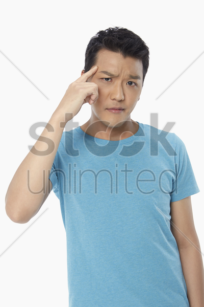 man with an uncertain look on his face stock photo