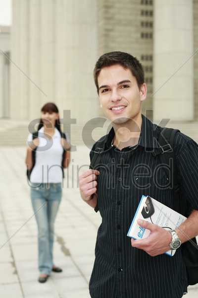 man with backpack and book stock photo