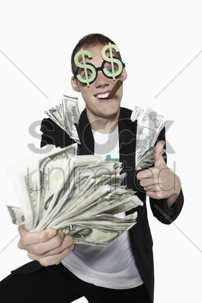 man with bank notes showing thumbs up stock photo