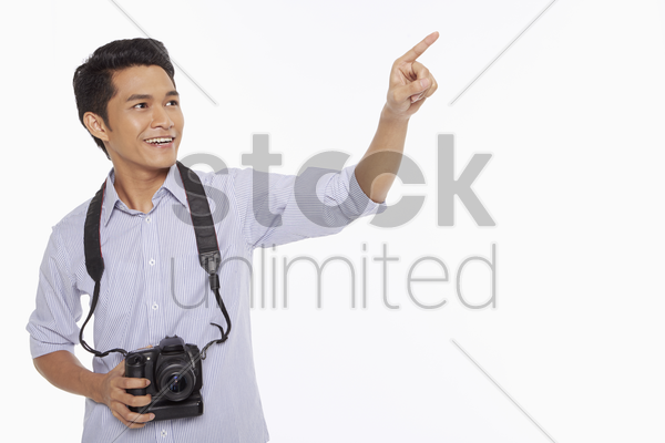 man with digital camera pointing to the left stock photo