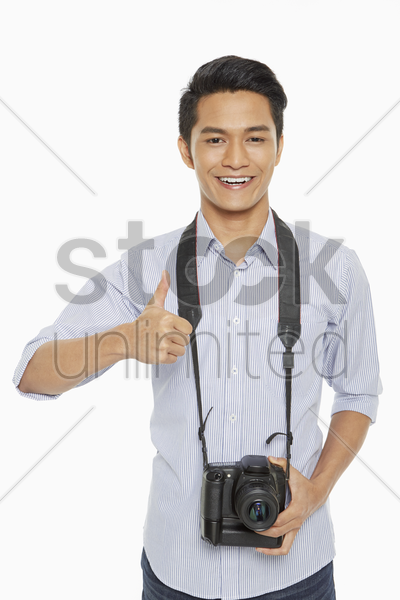 man with digital camera, smiling stock photo