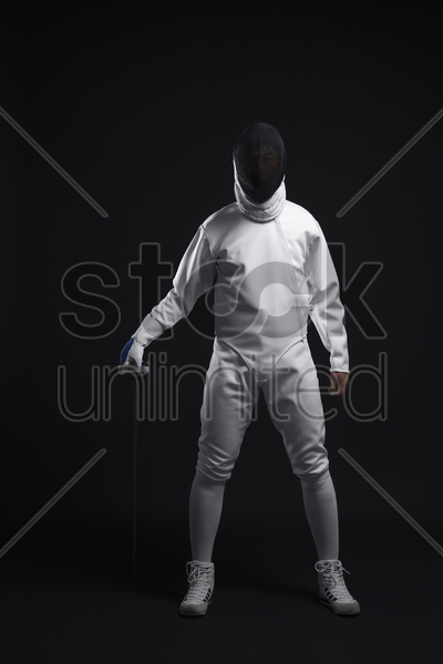 man with fencing foil stock photo