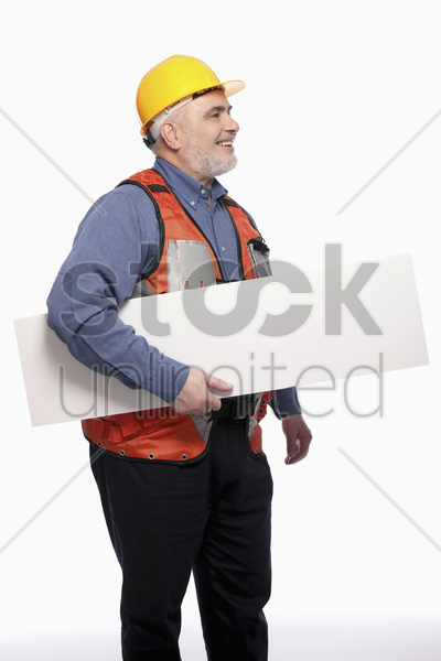 man with hardhat holding a placard stock photo