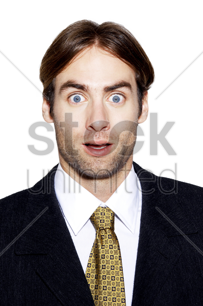 man with his eyes opened wide stock photo