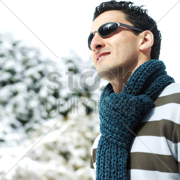 man with scarf and sunglasses stock photo